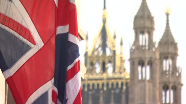 further allegations emerge westminster ext union jack flag outside parliament with victoria tower behind - victoria tower stock-videos und b-roll-filmmaterial