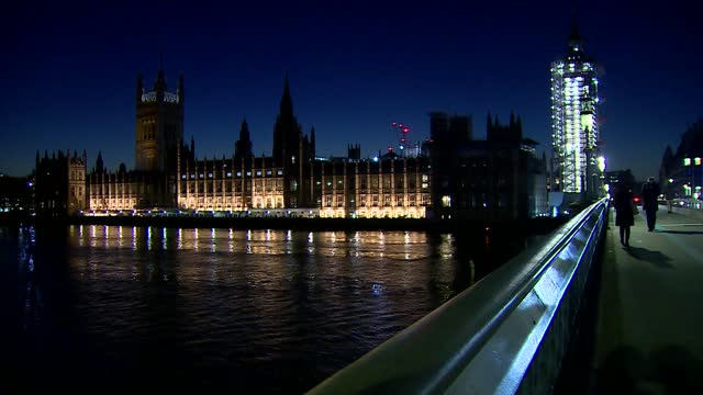 stockvideo's en b-roll-footage met westminster and palace of westminster gvs; england: london: westminster: ext / night gvs skyscrapers overlooking river thames at westminster with... - victoria tower