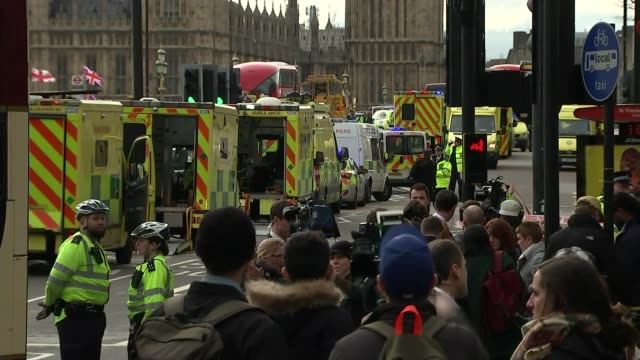 fourth victim named / prince charles visits injured in hospital 2232017 ambulances and police officers on westminster bridge - westminster bridge stock-videos und b-roll-filmmaterial