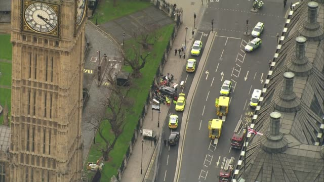 westminster attack aftermath: khalid masood background / police investigation; lib / 22.3.2017 england: london: westminster: ext air view / aerial... - surrounding wall点の映像素材/bロール