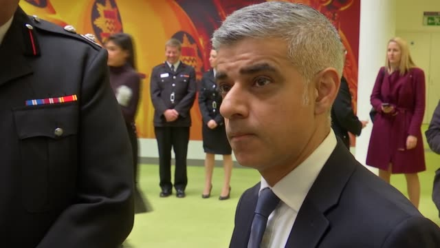 sadiq khan visits london fire brigade sadiq khan talking to group of firefighters sot - brigade stock videos & royalty-free footage