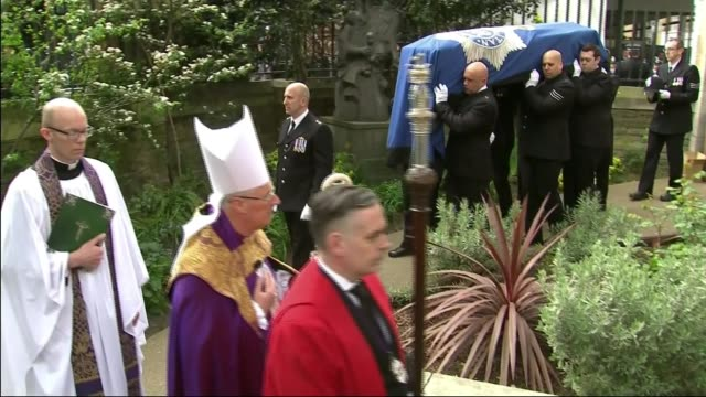 funeral of pc keith palmer westminster attack funeral of pc keith palmer various of coffin of pc keith palmer draped in the metropolitan police flag... - exeter cathedral stock videos & royalty-free footage