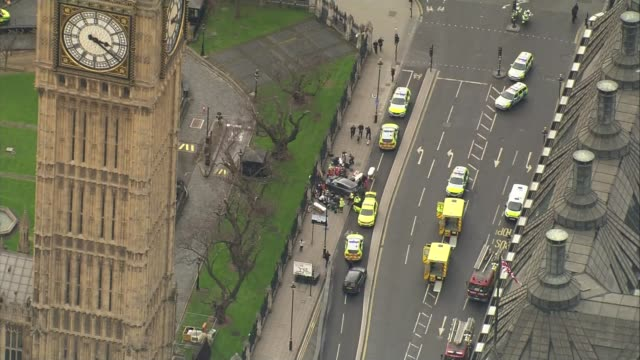 one man remains in custody / calls for review of Parliament security ENGLAND London Westminster VIEW / AERIAL car crashed into New Palace Yard fence...