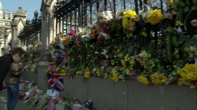 Questions raised by families of victims at hearing before inquest R270317011 / ENGLAND London Westminster Houses of Parliament EXT Floral tribute on...