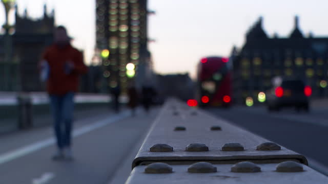 westminster bridge at dusk with houses of parliament in background - image focus technique stock videos & royalty-free footage
