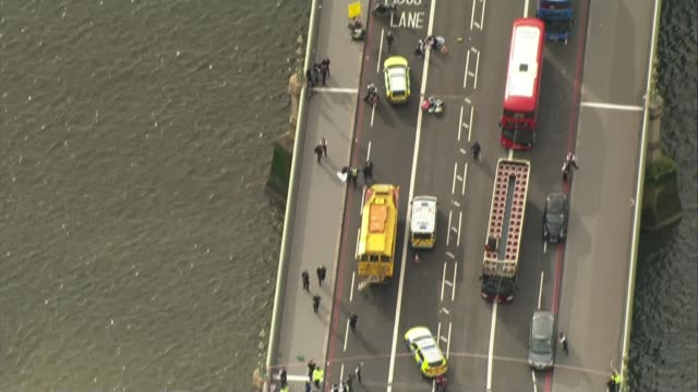 victims remembered in parliament on first anniversary lib / westminster bridge traffic ambulances emergency services and injured people on... - westminster bridge stock-videos und b-roll-filmmaterial