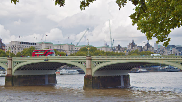 westminster bridge in london. road. red bus. thames river. - riverbank stock videos & royalty-free footage