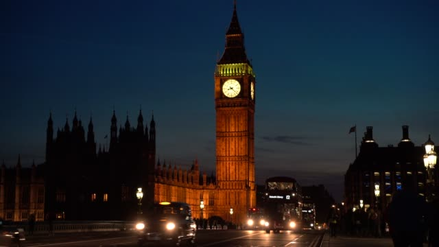 westminster bridge with big ben in london, uk - big ben stock videos & royalty-free footage