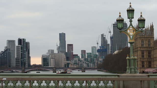 westminster bridge with london skyscrapers under construction in background. an influx of cash-rich hong kong buyers is barely making a dent in... - skyline stock videos & royalty-free footage