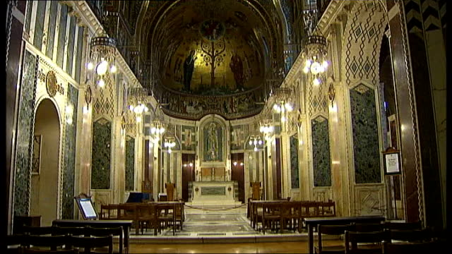 westminster cathedral structural damage; general views of interior of westminster cathedral including cross hanging from ceiling, domed roof, gold... - westminster cathedral stock videos & royalty-free footage