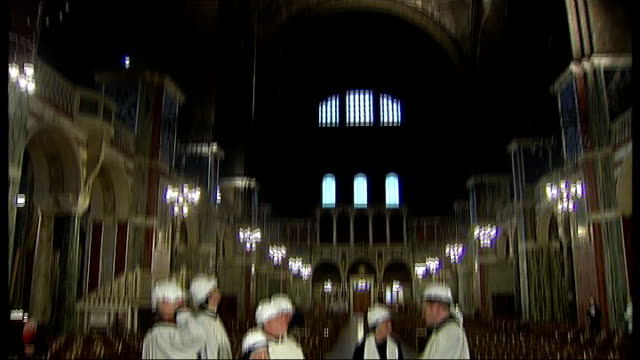 westminster cathedral structural damage; photocall of priests and nuns wearing construction workers' hard hats/ old electrical wiring in section of... - westminster cathedral stock videos & royalty-free footage