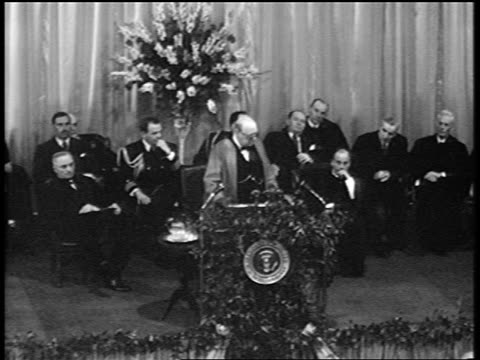 b/w 1946 high angle winston churchill speaks into microphones at podium / famous iron curtain speech - 1946年点の映像素材/bロール