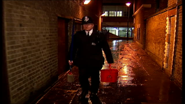 westminster council battle against public urination; music overlay: 'the a team' theme tune: police officer along alley with mop and bucket music ends - urinary system stock videos & royalty-free footage