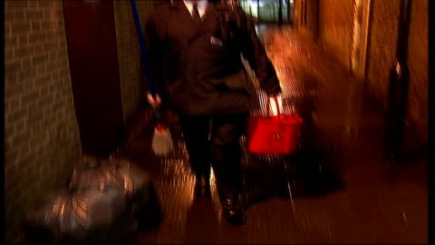 westminster council battle against public urination; music overlay: 'the a team' theme tune: police officer along alley with mop and bucket music ends - harnapparat stock-videos und b-roll-filmmaterial