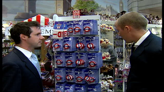westminster council copyrights london street signs baker street int goodman chatting to adam ficken as looking at london underground keyrings - メリルボーン点の映像素材/bロール