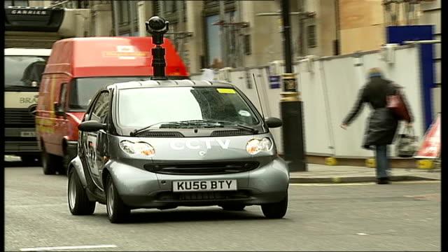vídeos de stock, filmes e b-roll de westminster council introduces mobile surveillance cameras; smart car fitted with surveillance camera along - smart