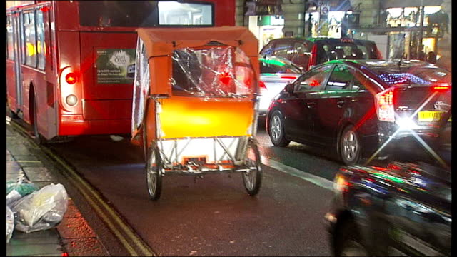 Westminster Council warns pedicabs are potentially dangerous ENGLAND London Pedicab driving close behind bus Pedicabs along in West End