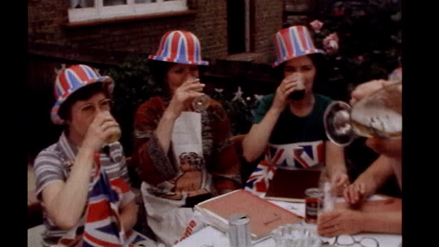westminster councils looks at requests for royal wedding street parties r09099721/itn originally tx'd 7677 people in union jack hats raising glasses... - street party stock videos and b-roll footage