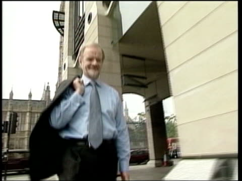 westminster: ext cms former cabinet minister robin cook mp along track - mp stock-videos und b-roll-filmmaterial