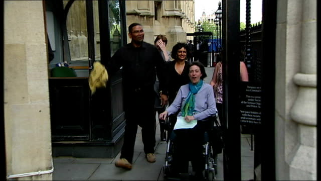stockvideo's en b-roll-footage met westminster: ext debbie purdy along in wheelchair with omar puente various of purdy and puente press conference , purdy and puente as kiss - puente
