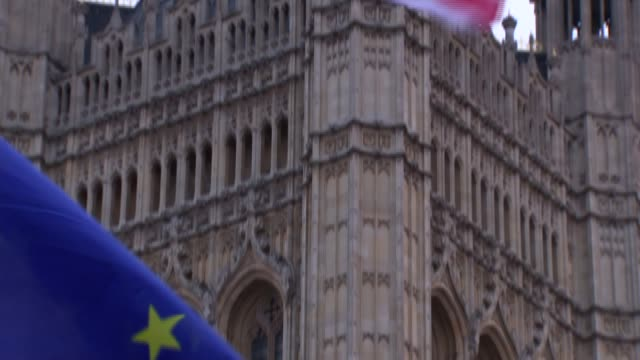 London Westminster EXT Group of Brexit protesters / back view of woman standing near teleprompter / reporters and camera operators / Brexit...