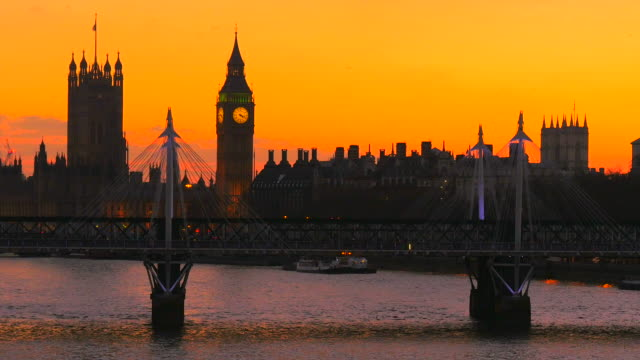 westminster palace, big ben and hungerford bridge in the evening, london, england, great britain - hungerford bridge stock videos & royalty-free footage
