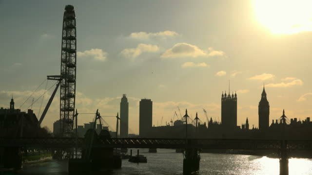 westminster palace, big ben, london eye and hungerford bridge in the evening, london, england, great britain - hungerford bridge stock videos & royalty-free footage