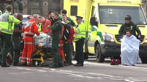westminster terror attack: five dead and at least 40 injured; injured people being treated by paramedics on westminster bridge - terrorism stock videos & royalty-free footage