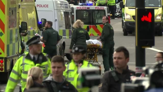 Injured in hospital ENGLAND London EXT Paramedics and police at scene of Westminster terror attack PAN injured person on stretcher Paramedics...