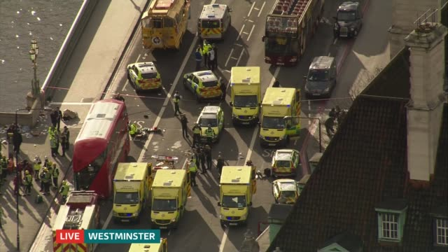 itv news special 1600 1650 **patrick daly interview overlaid sot** ambulance along westminster bridge past other ambulances - westminster bridge stock-videos und b-roll-filmmaterial