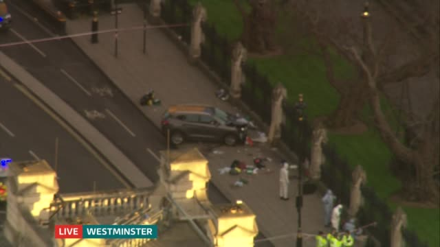 ITV News Special 1650 1800 AIR VIEWS Houses of Parliament / crashed car on pavement with forensic officers nearby / emergency services on Westminster...