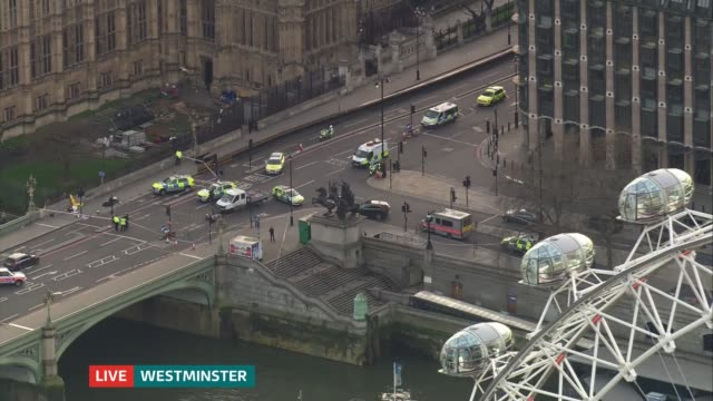 itv news special 1650 1800 **glenmore trenearharvey interview overlaid sot** police vehicles parked near westminster bridge and houses of parliament - westminster bridge stock-videos und b-roll-filmmaterial
