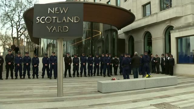 Khalid Masood named as attacker / police investigation New Scotland Yard EXT Police officers stand for minute's silence outside new Scotland Yard HQ...