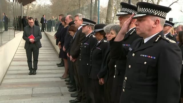 Khalid Masood named as attacker / police investigation Westminster EXT Police officers stand for minute's silence outside new Scotland Yard HQ Curtis...