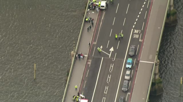 khalid masood named as attacker / police investigation 2232017 police cars and injured on westminster bridge in immediate aftermath of westminster... - westminster bridge stock-videos und b-roll-filmmaterial