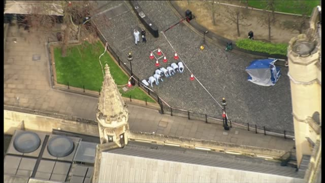 Khalid Masood named as attacker / police investigation London Westminster Houses of Parliament VIEW / AERIAL police forensic officers on hands and...