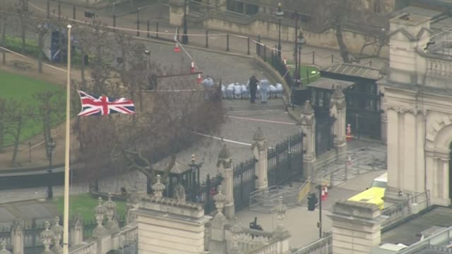 Khalid Masood named as attacker / police investigation Westmnster Union Jack flag flying at half mast outside Houses of Parliament police forensic...