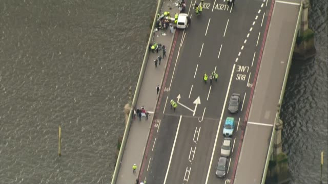 Khalid Masood named as attacker / police investigation 2232017 Police cars and injured on Westminster Bridge in immediate aftermath of Westminster...