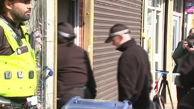 khalid masood named as attacker / police investigation west midlands birmingham police officers on guard at entrance to property where arrests were... - west midlands stock videos and b-roll footage