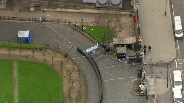 Khalid Masood named as attacker / police investigation ENGLAND London Westminster Houses of Parliament VIEWs / AERIALs police forensic officers on...
