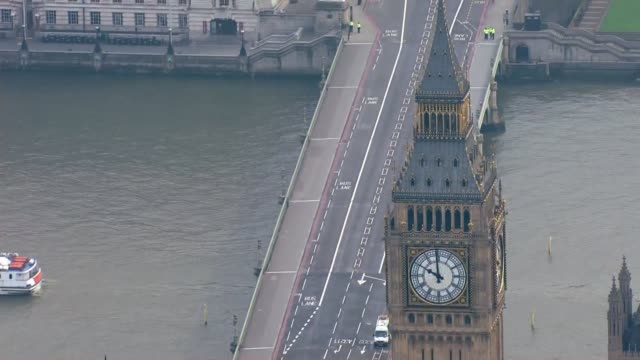 london carries on air view / aerial closed westminster bridge with big ben in foreground - house of commons stock videos and b-roll footage