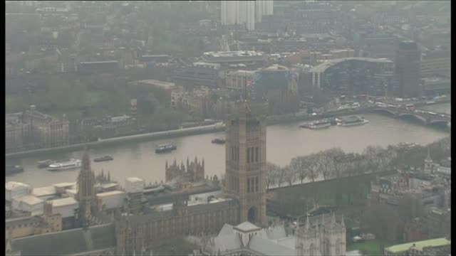 tributes paid to victims ENGLAND London Houses of Parliament with Union Jack flag atop Victoria Tower flying at half mast