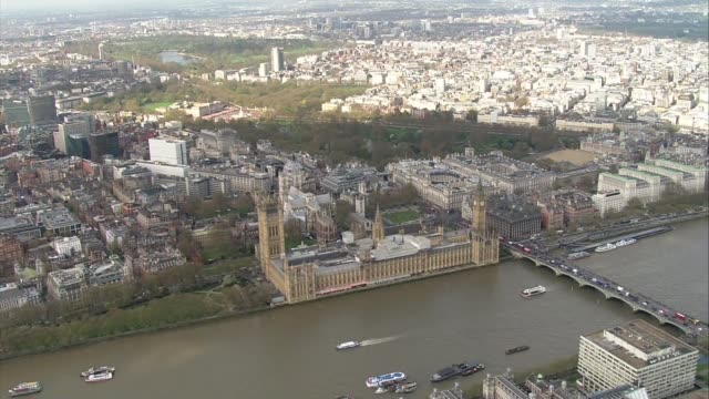 westminster abbey service aerials air views / aerials westminster bridge / floral tributes in parliament square for westminster bridge terror attack... - victoria tower stock-videos und b-roll-filmmaterial