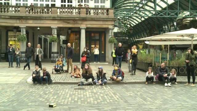 westminster's buskers protest restrictions england london covent garden ext spikey interview sot reporter to camera sot street performer doing... - balance stock videos & royalty-free footage