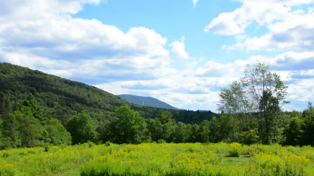 Weston Vermont scenic of mountains and Magic Mountain SKi Resort in distance summer clouds and sunshine wide open space