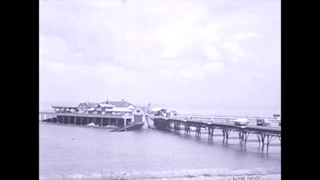 weston-super-mare marine parade 1949 / birnbeck island lifeboat station / steamship / lady walks past camera - pan down marine parade / second... - 1940 1949 video stock e b–roll