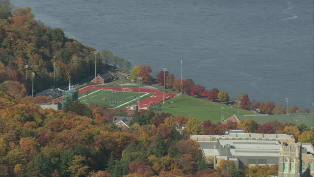 stockvideo's en b-roll-footage met aerial westpoint military academy along the hudson river / new york, united states - west point new york