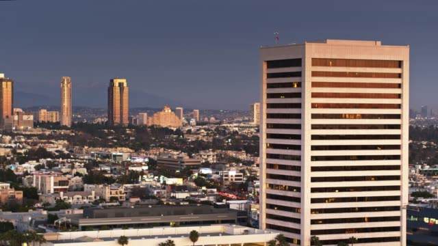 westwood and century city at sunset - aerial view - westwood neighborhood los angeles stock videos & royalty-free footage