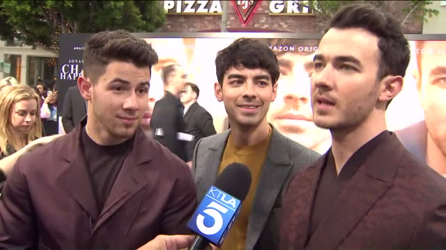 westwood, ca, u.s., - interview with jonas brothers at chasing happiness premiere on monday, june 3, 2019. - premiere event stock videos & royalty-free footage