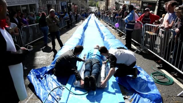 wet and wild action was taking place in bristol in south west england on sunday as participants took part in the bristol park and slide project an... - temporary stock videos & royalty-free footage